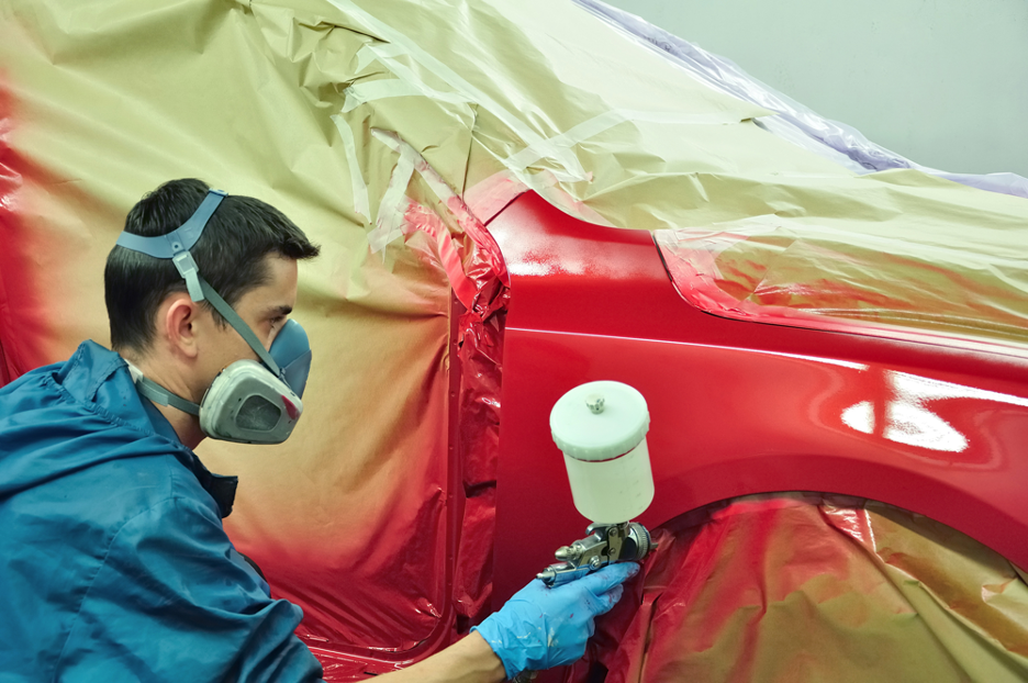 Auto Body Painting At A Repair Shop
