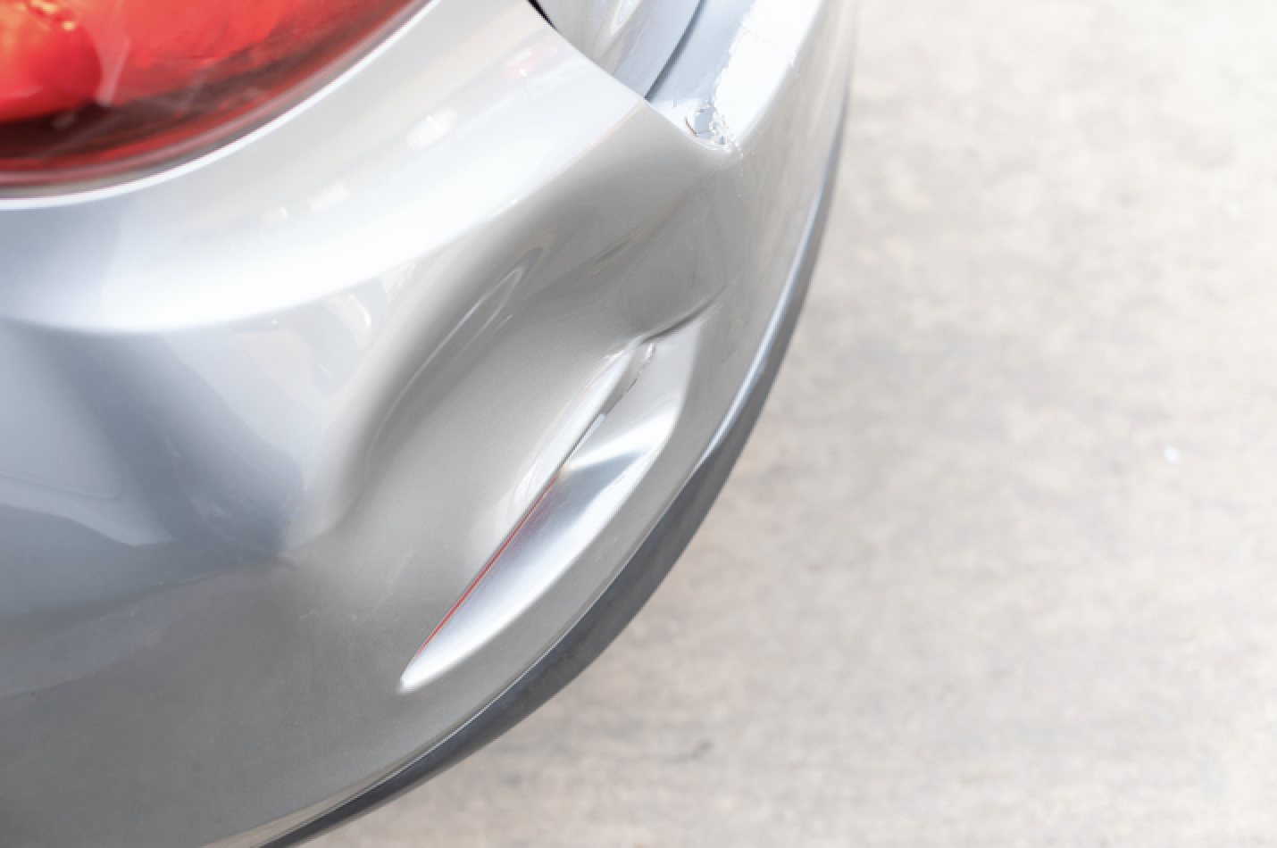 Dented Car Bumper Repair At An Auto Body Shop In Oak Brook, Illinois