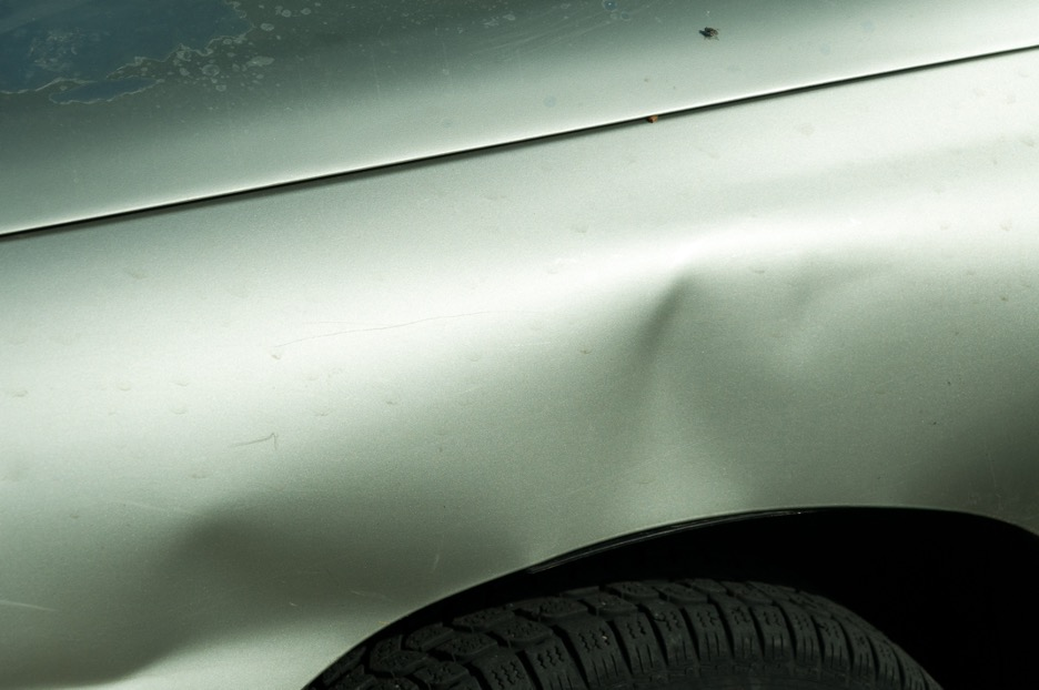 Paintless Dent Repair On A Vehicle In Glendale Heights, Illinois