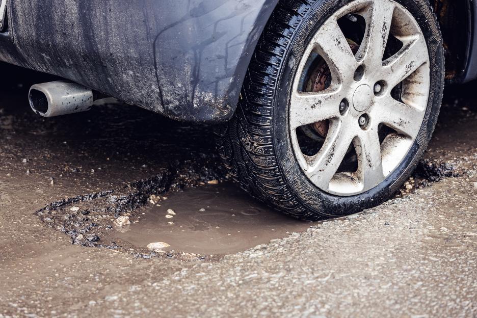 Pothole Damage Auto Body Repair Shop In Westchester, Illinois